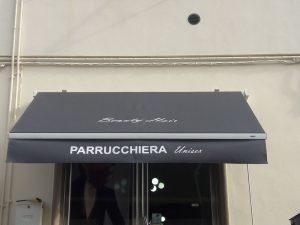 tenda a bracci personalizzata con logo per negozio di parrucchiera